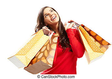 Portrait of happy girl with colorful paper bags over white background