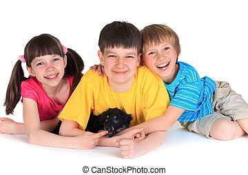 Happy siblings with puppy