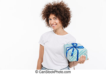 Happy smiling woman holding a present box