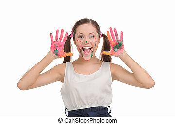 Happy teenage girl. Excited young woman with pigtails showing her hands stained in paint while isolated on white