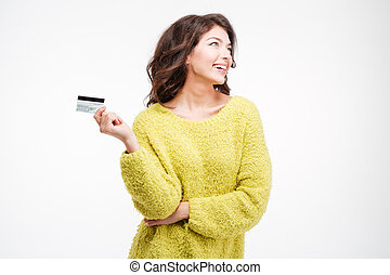 Happy thoughtful woman holding bank card