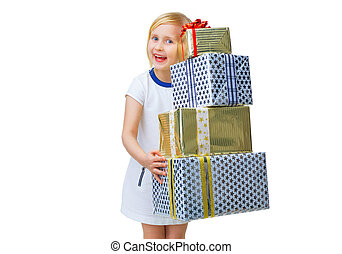 happy trendy child on white holding pile of Christmas gifts