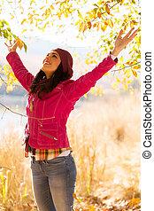 woman enjoying autumn outdoors