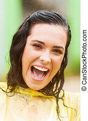 happy woman face closeup in the rain