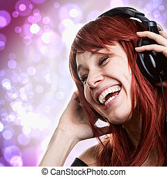 Happy young woman having fun with music headphones