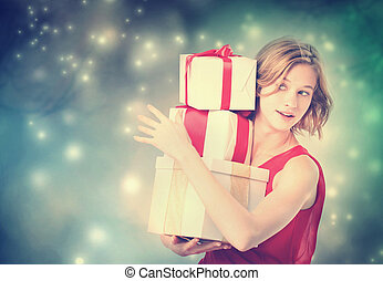 Happy woman holding a many present boxes