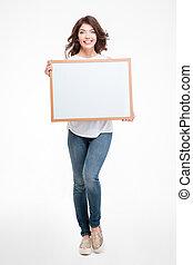 Happy woman holding blank board