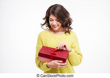 Happy woman holding present box