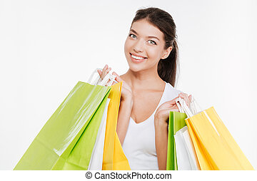 Happy woman holding purchasings after shopping