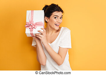 Happy woman holding surprise gift box present