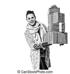 happy woman on white with pile of Christmas giftes walking