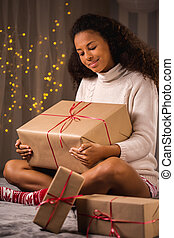 Happy woman with christmas gifts