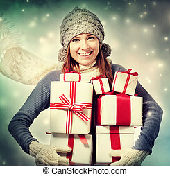 Happy woman with present boxes