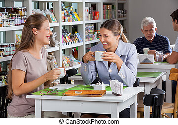 Happy Women Having Coffee At Supermarket