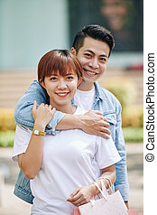 Happy young Asian man and woman