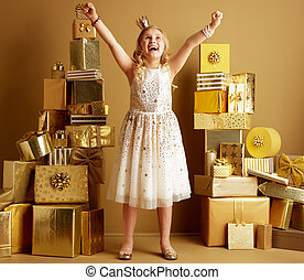 happy young child rejoicing