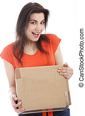 Happy young woman holding a cardboard box