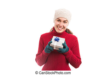 Happy young woman holding a gift box smiling
