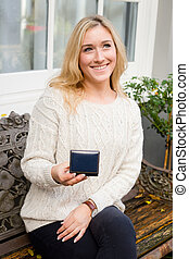 happy young woman holding a jewelry box