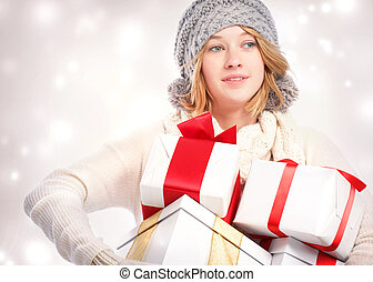 Happy young woman holding many gift boxes