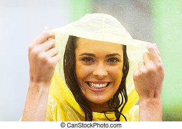 woman in poncho in the rain