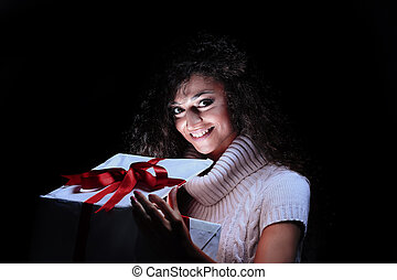 Happy young woman opening a Christmas present