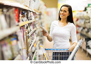 young woman shopping at hardware store