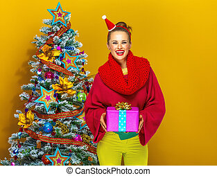 happy young woman showing Christmas present box