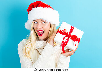 Happy young woman with Christmas gift