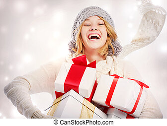 Happy Young Woman with Christmas Gifts