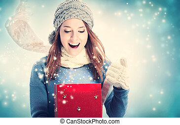 Happy young woman with Christmas present box