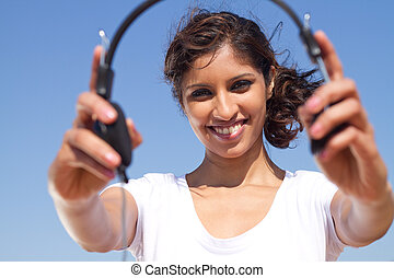 happy young woman with earphones
