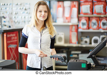 Hardware seller or sale assistant cashier accepting credit card as payment for purchase