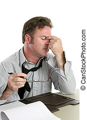 A businessman at work with a severe headache. White background