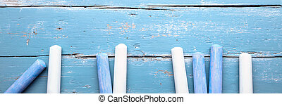Header, blue and white crayon, concept eduaction and childhood