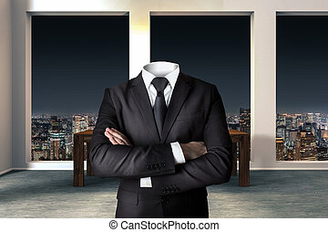 headless businessman with crossed arms in modern urban office