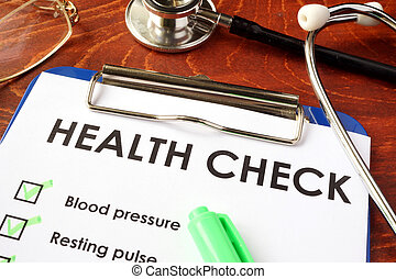 Health check form on a clipboard.