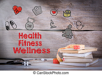 Health, Fitness, Wellness. Stack of books and a stethoscope on a wooden background