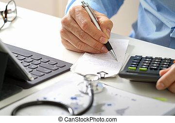 Healthcare costs and fees concept. Hand of smart doctor used a calculator for medical costs in modern hospital