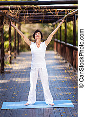healthy middle aged woman arms reach out