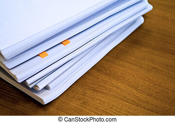 heap of documents on table