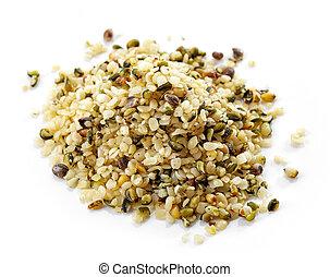 heap of hemp seeds isolated on white