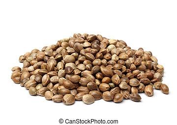 Heap of hemp seeds on white backround