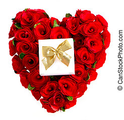 heart of red roses with a gift box