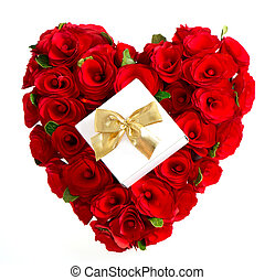 heart of red roses with gift and golden bow