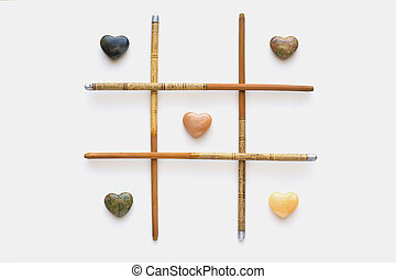 Agate hearts and chinese bamboo chopsticks.