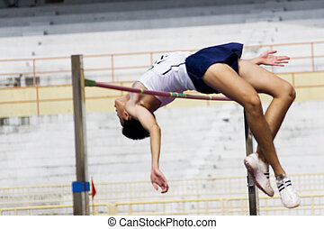 Image of a high jumper in action with intentional blurring to portray speed.