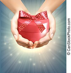 Holiday background with hands holding gift box. Concept of giving presents.