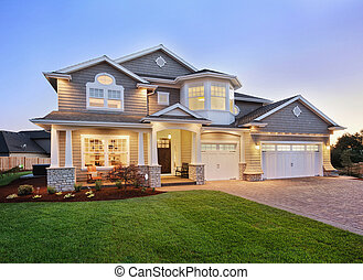 luxury home exterior with green grass and driveway