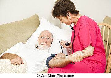 Home Health Nurse Takes Blood Pressure